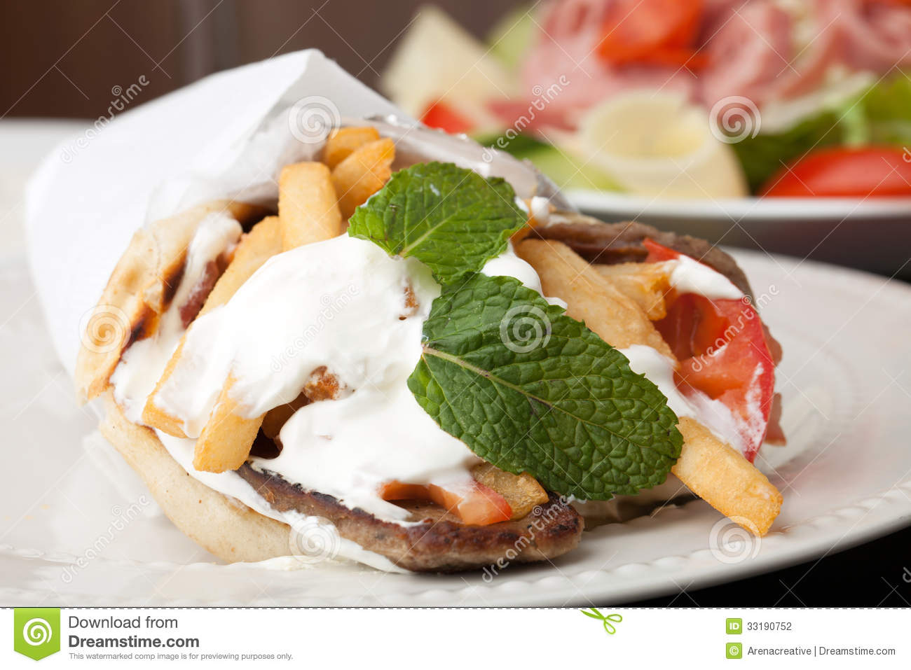 Traditional Gyro sandwich with meat tzatziki sauce tomato onions and ...