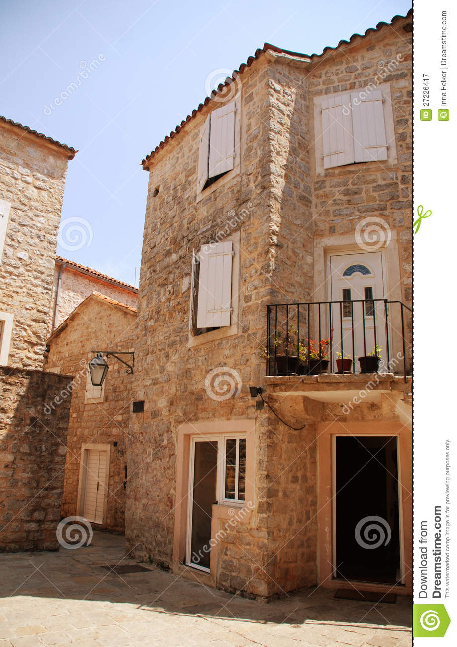 House windows with shutters - Mediterranean Stone Houses With Window Shutters And Medieval Paving