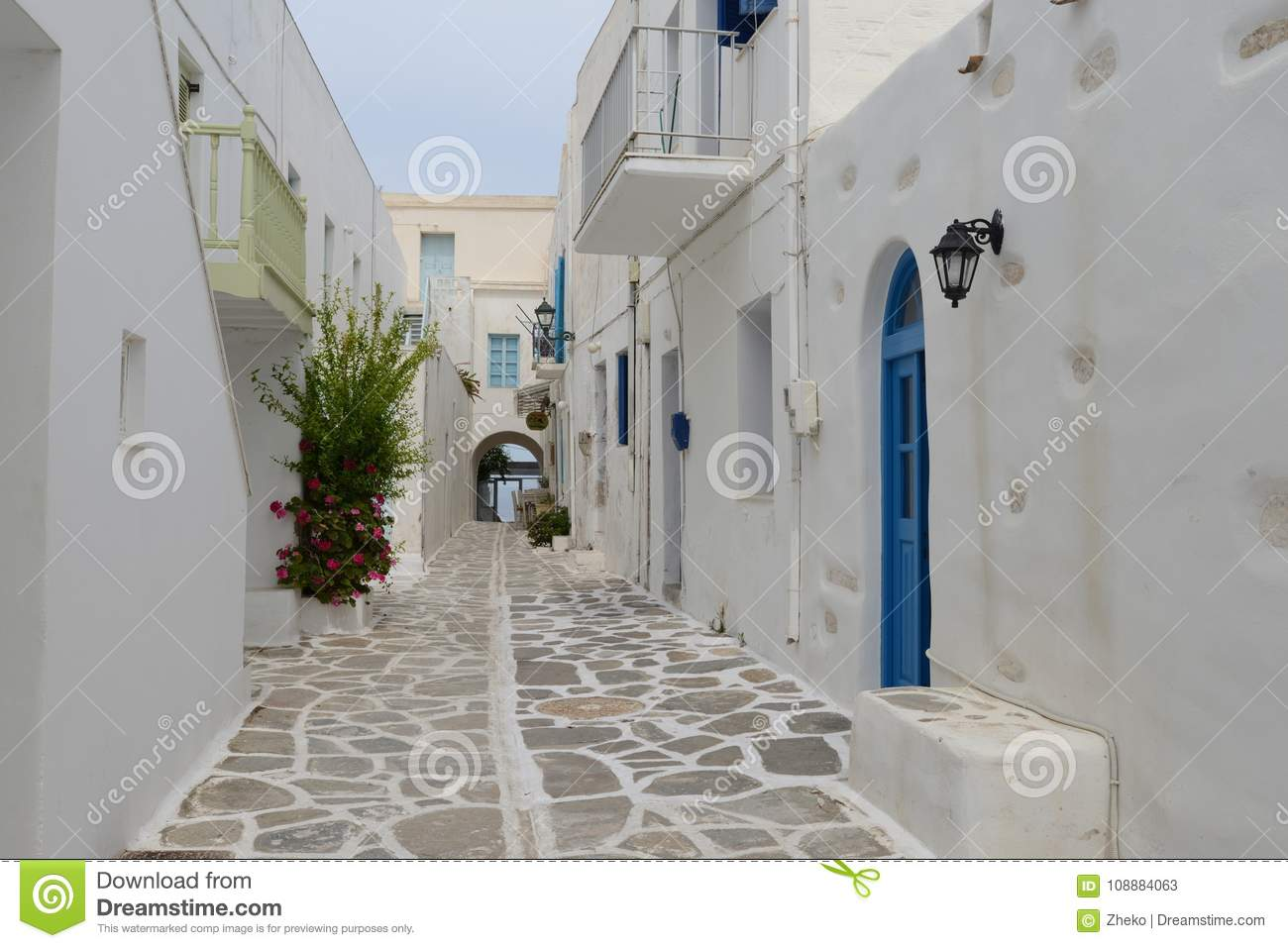 Mediterranean street with white houses and blue doors