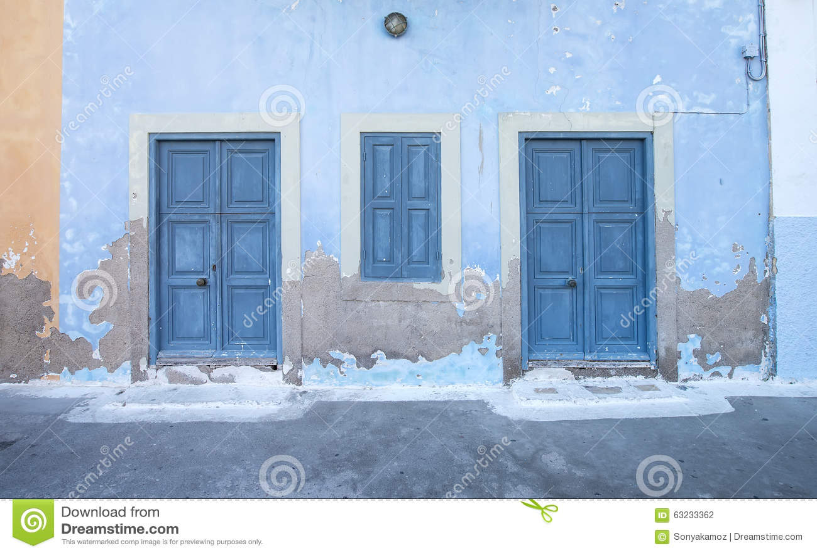 Mediterranean style exterior. Blue wooden doors