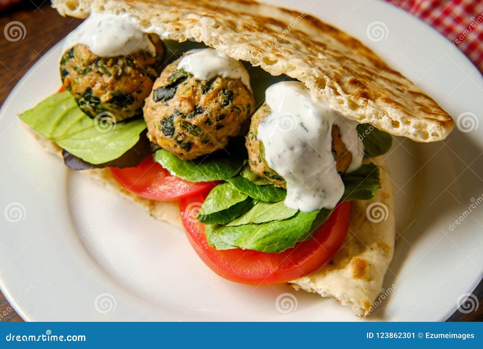 95b256219b0050 Mediterranean turkey meatball sandwich on pita bread with dill yogurt sauce