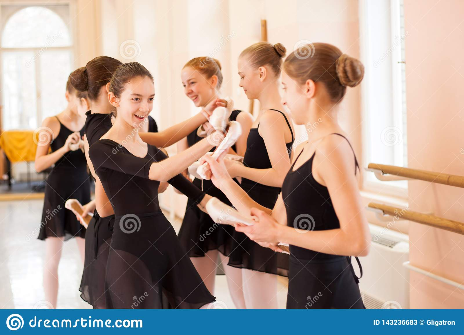 Medium group of teenage girls having fun and relaxing after ballet class
