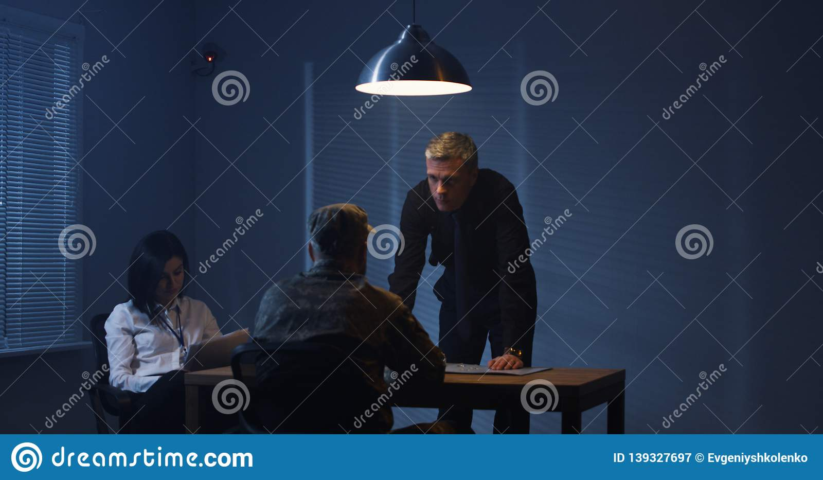 Investigators interrogating a soldier