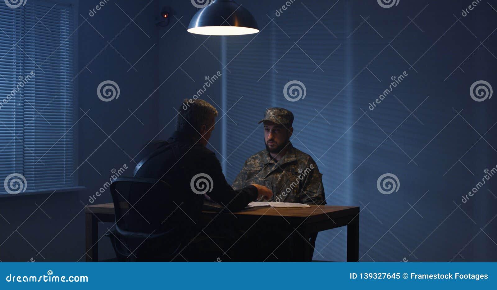 Policeman interrogating a soldier