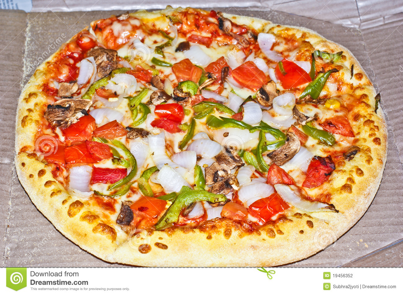 medium sized pizza with cheese,tomatoes,capsicum and onion as toppings ...