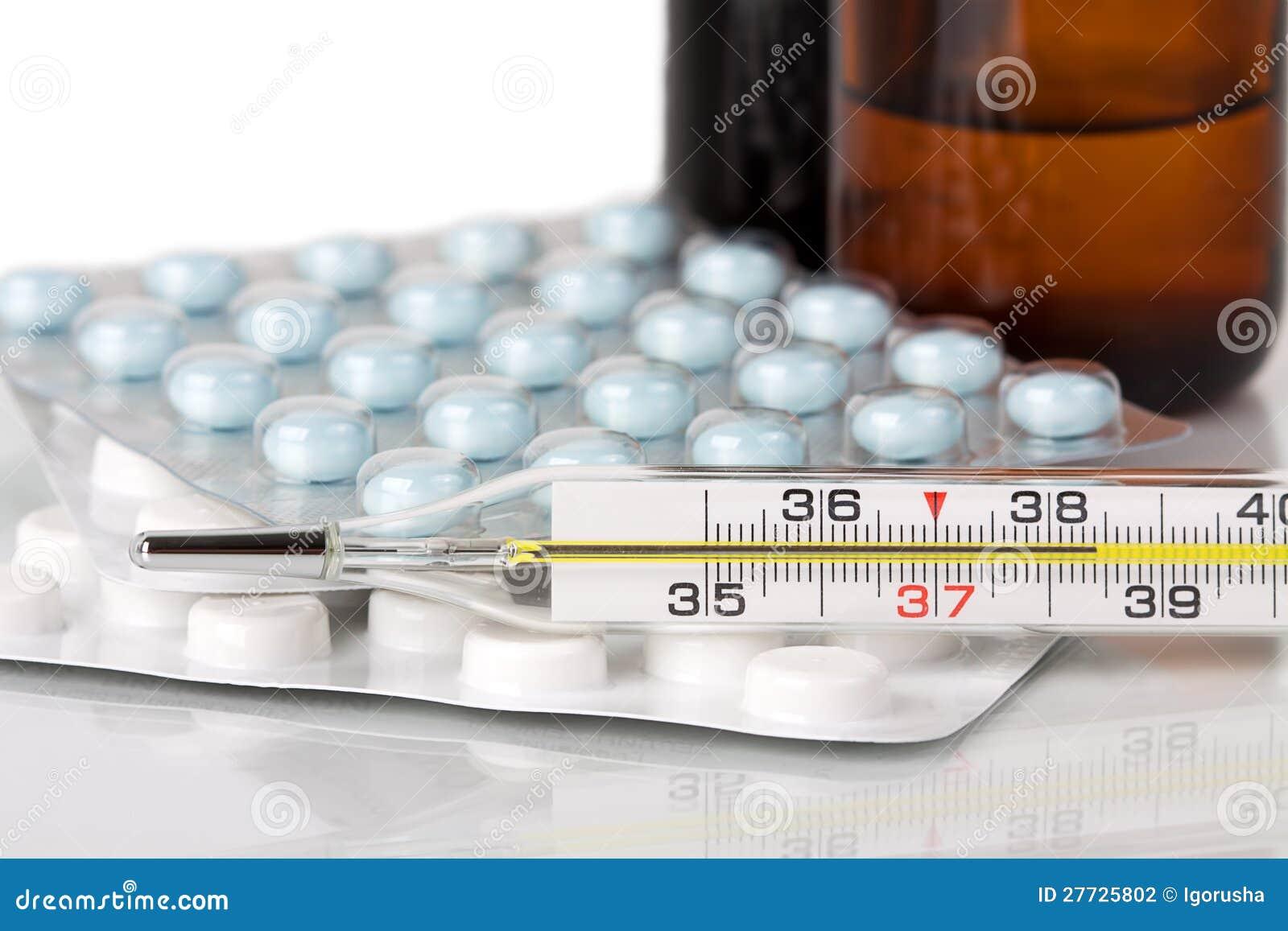 Medizinischer Thermometer und Pillen