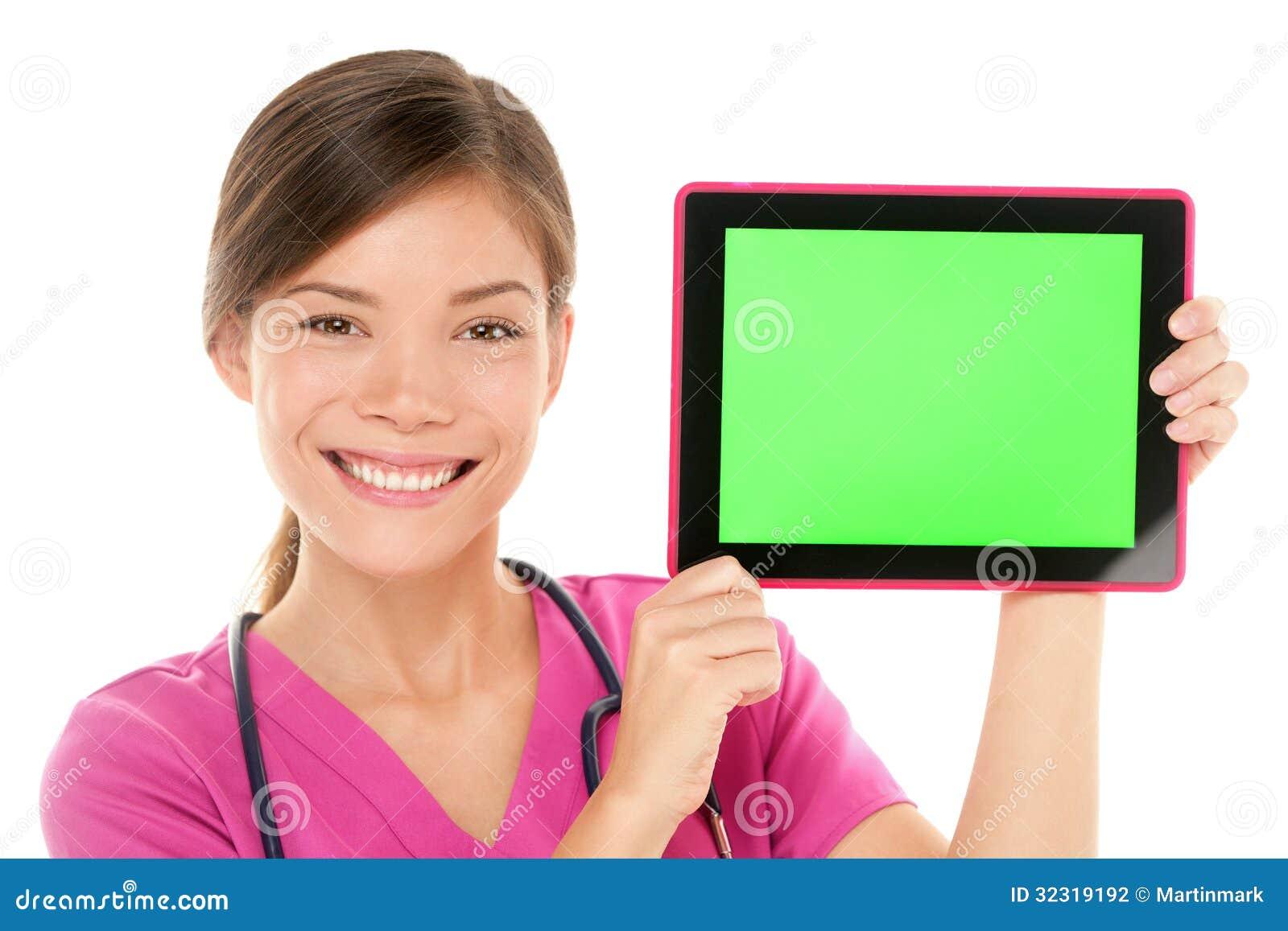 Medycznej pielęgniarki pastylki komputeru osobistego doktorski pokazuje ekran komputerowy