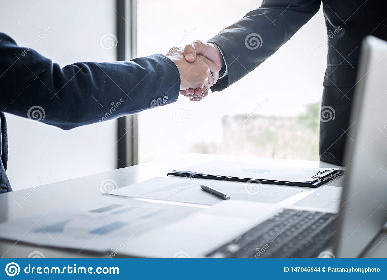 Meeting and greeting concept, Two confident Business handshake and business people after discussing good deal of Trading contract