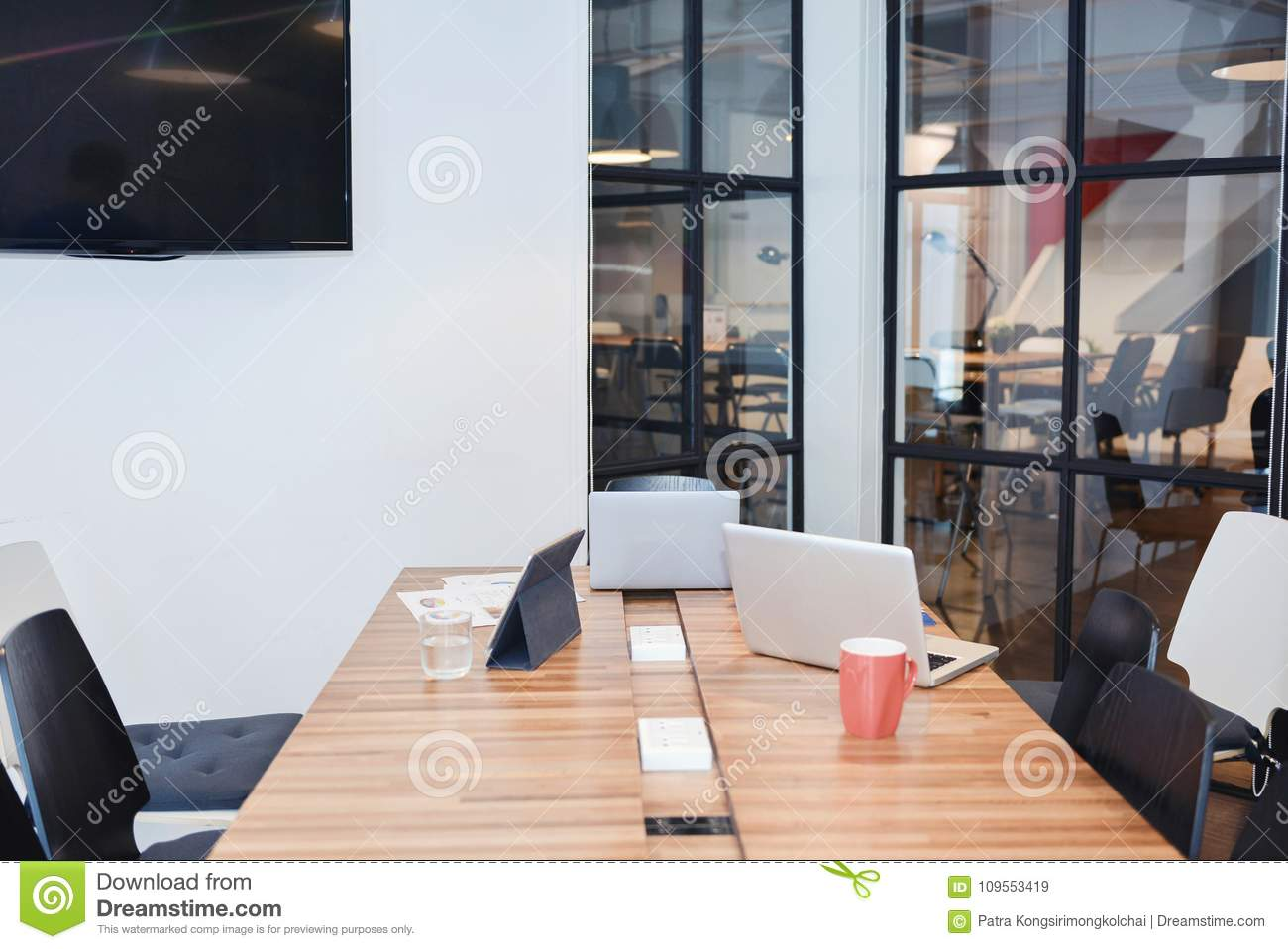 Meeting room with laptops and tablet in business concept, mock u