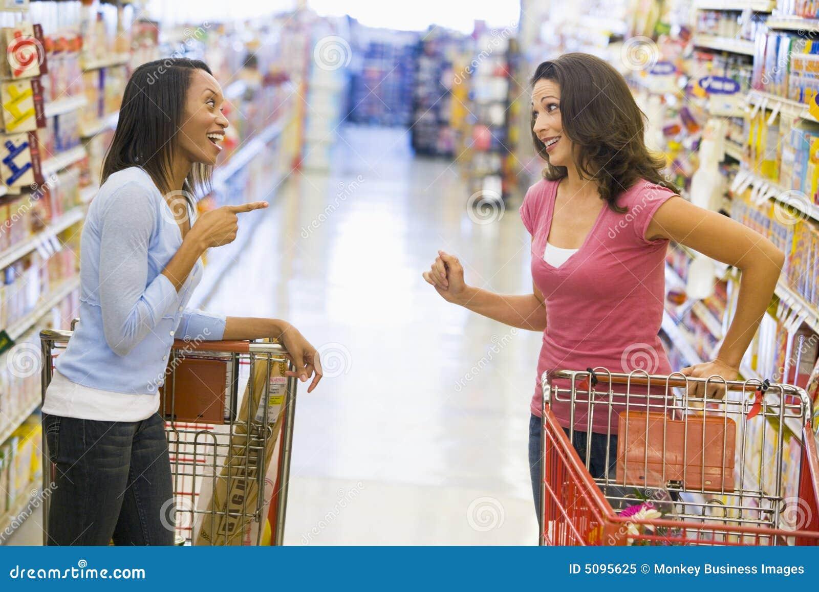Meeting supermarket two women