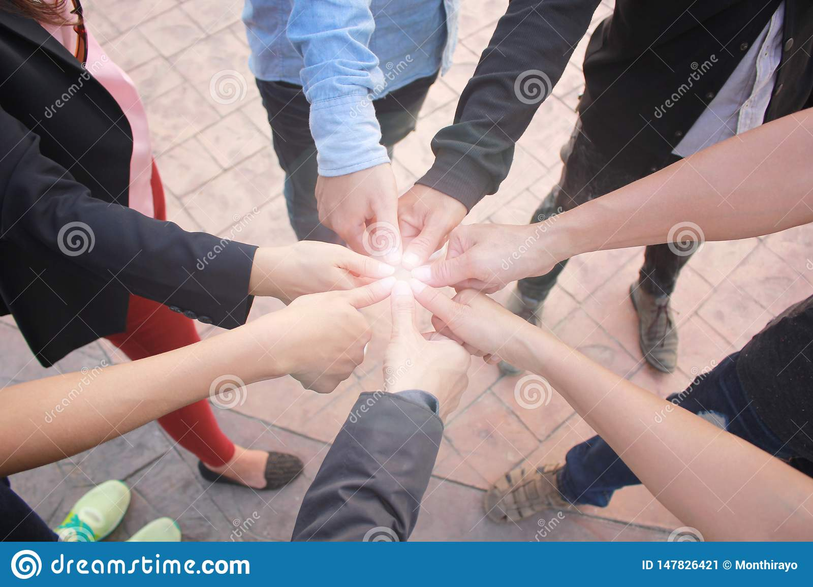 Meeting teamwork concept, Friendship group with hands showing unity and thumbs up on concrete floor background