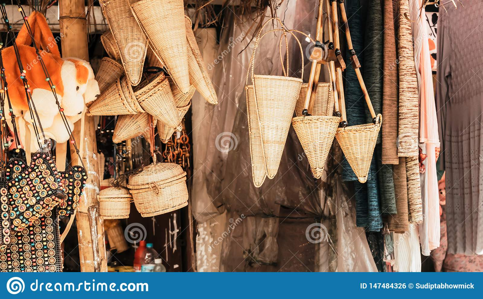 Meghalaya handicrafts art and crafts made with cane and bamboo products. Bamboo Cane work, Stools, Baskets, fishing traps,