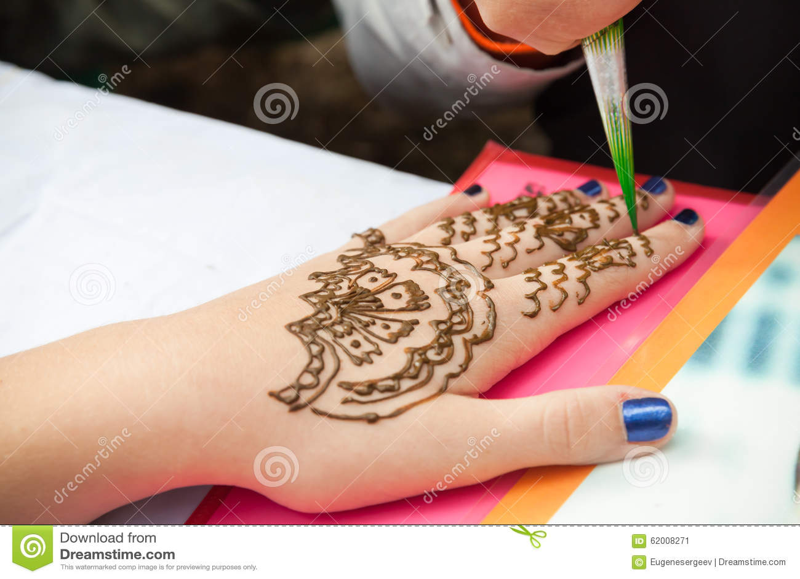 Mehndi application on woman hand skin decoration Application decoration