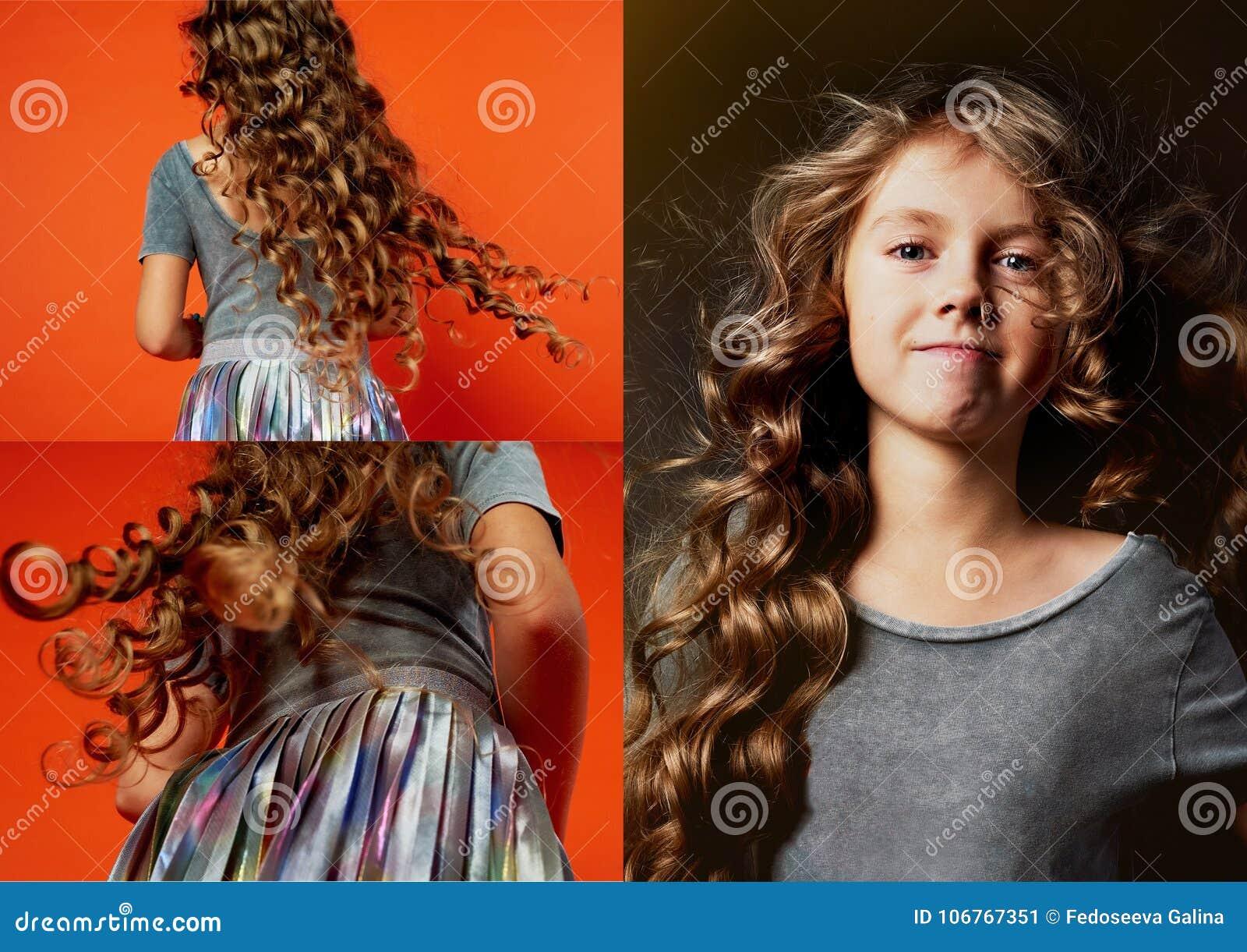 Meisje op oranje achtergrond in de studio zeer lang krullend haar