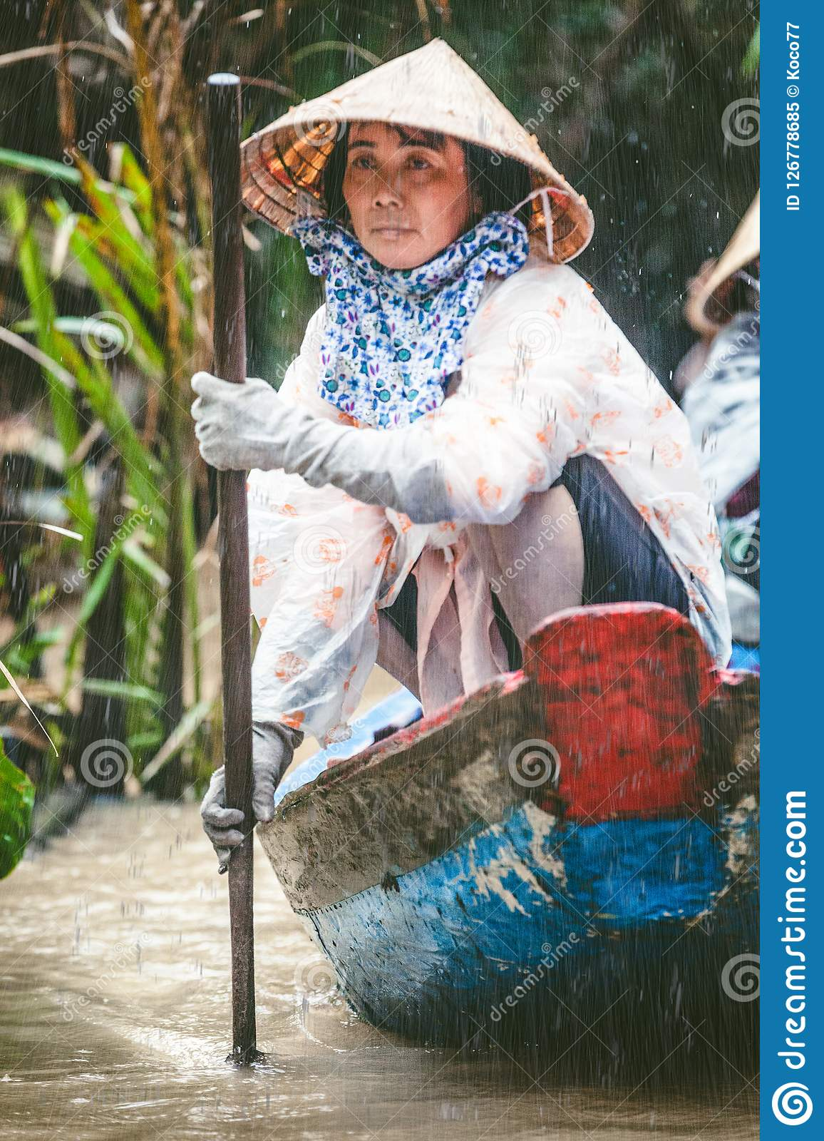 MEKONG, VIETNAM. Woman with her boat carrying tourists