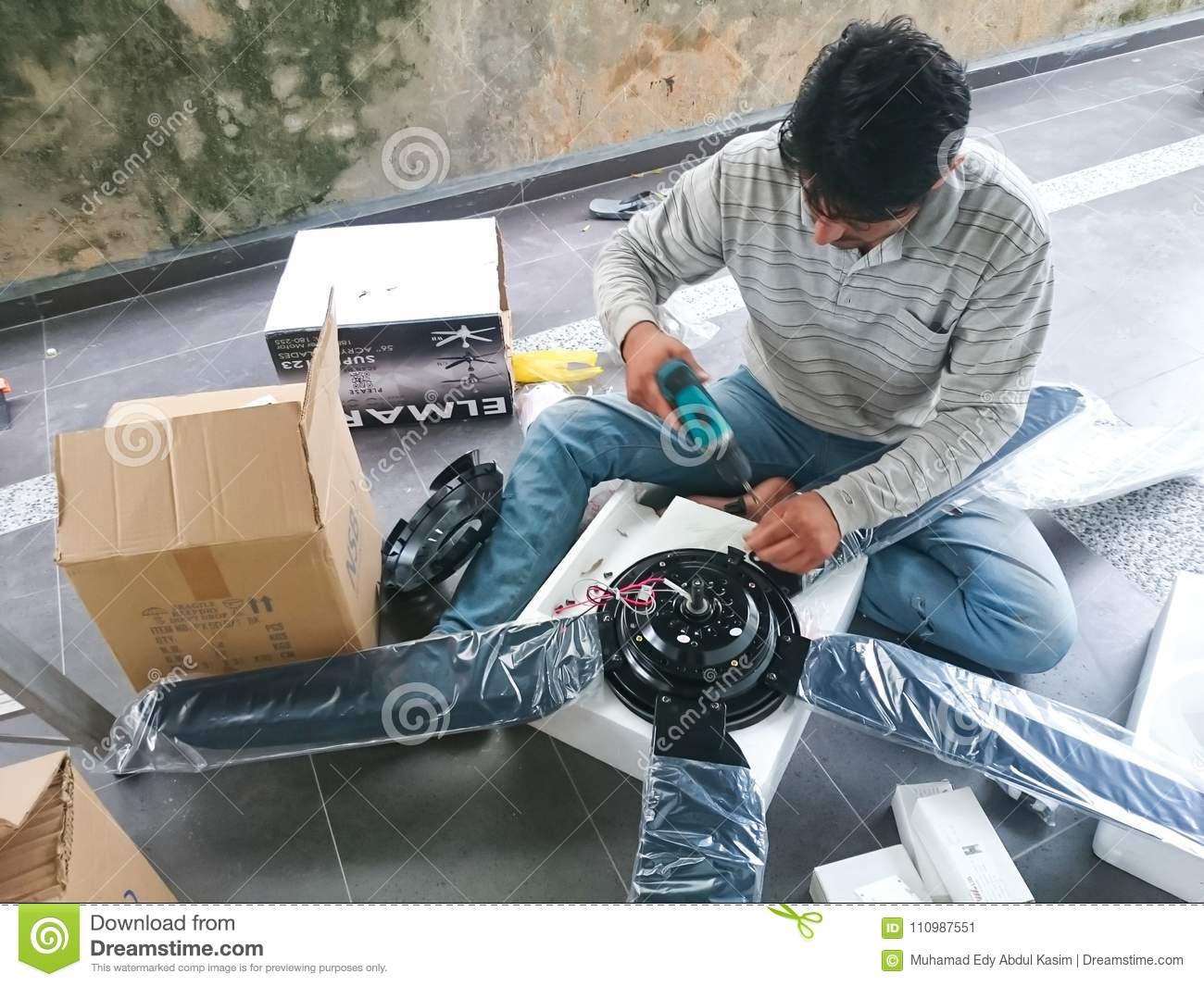 Electrical Man Install A Ceiling Fan Editorial Photo