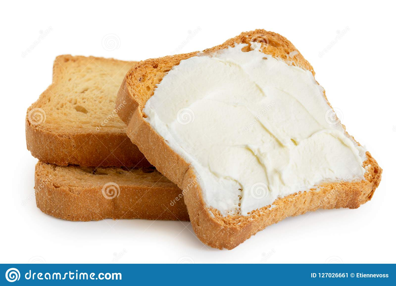 Melba rostat bröd med gräddost som ligger på två isolerade vanliga rostade bröd