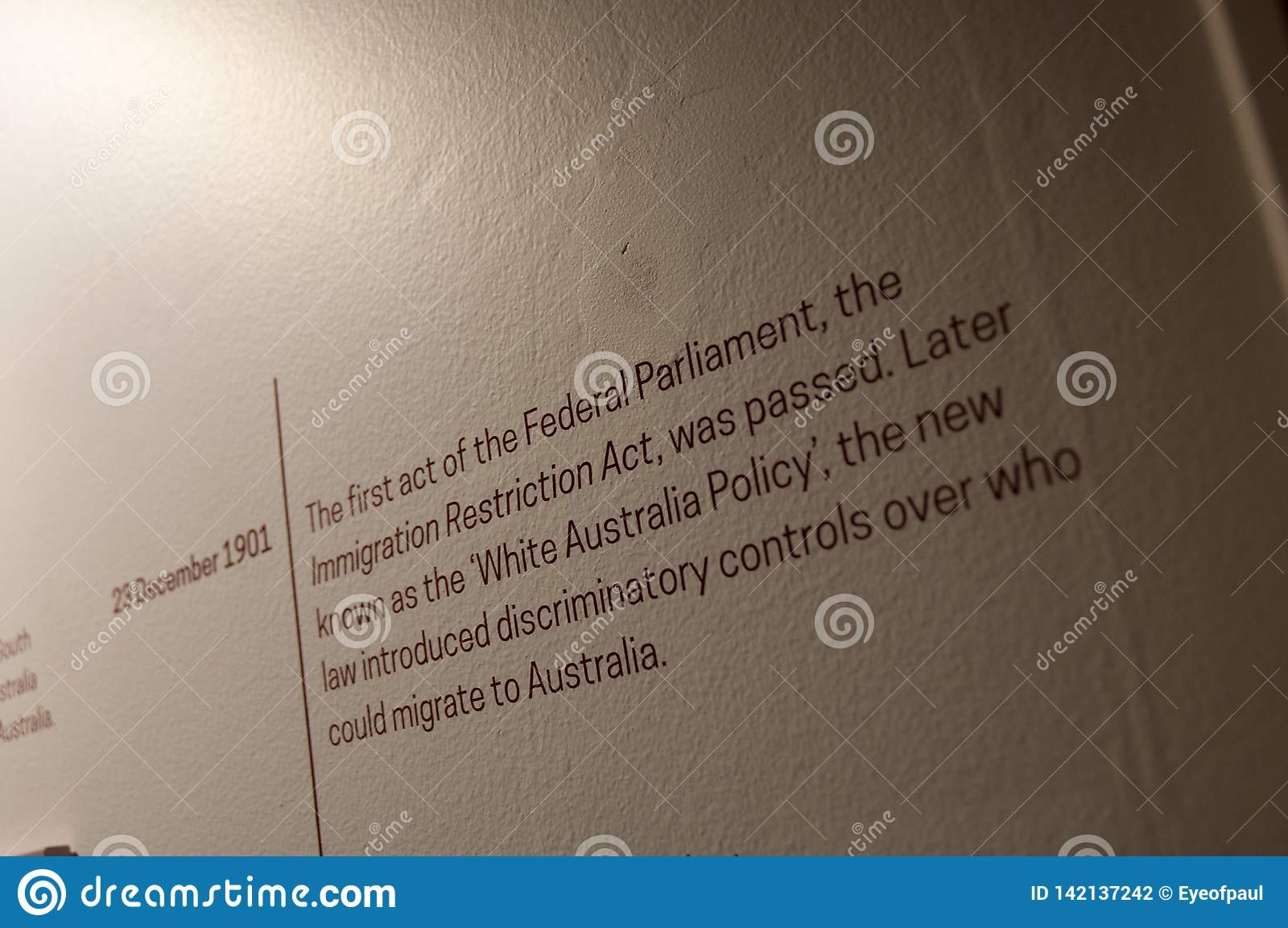 MELBOURNE, AUSTRALIA - JULY 26, 2018: White Australia Policy on 23 December 1901 explanation text on white wall
