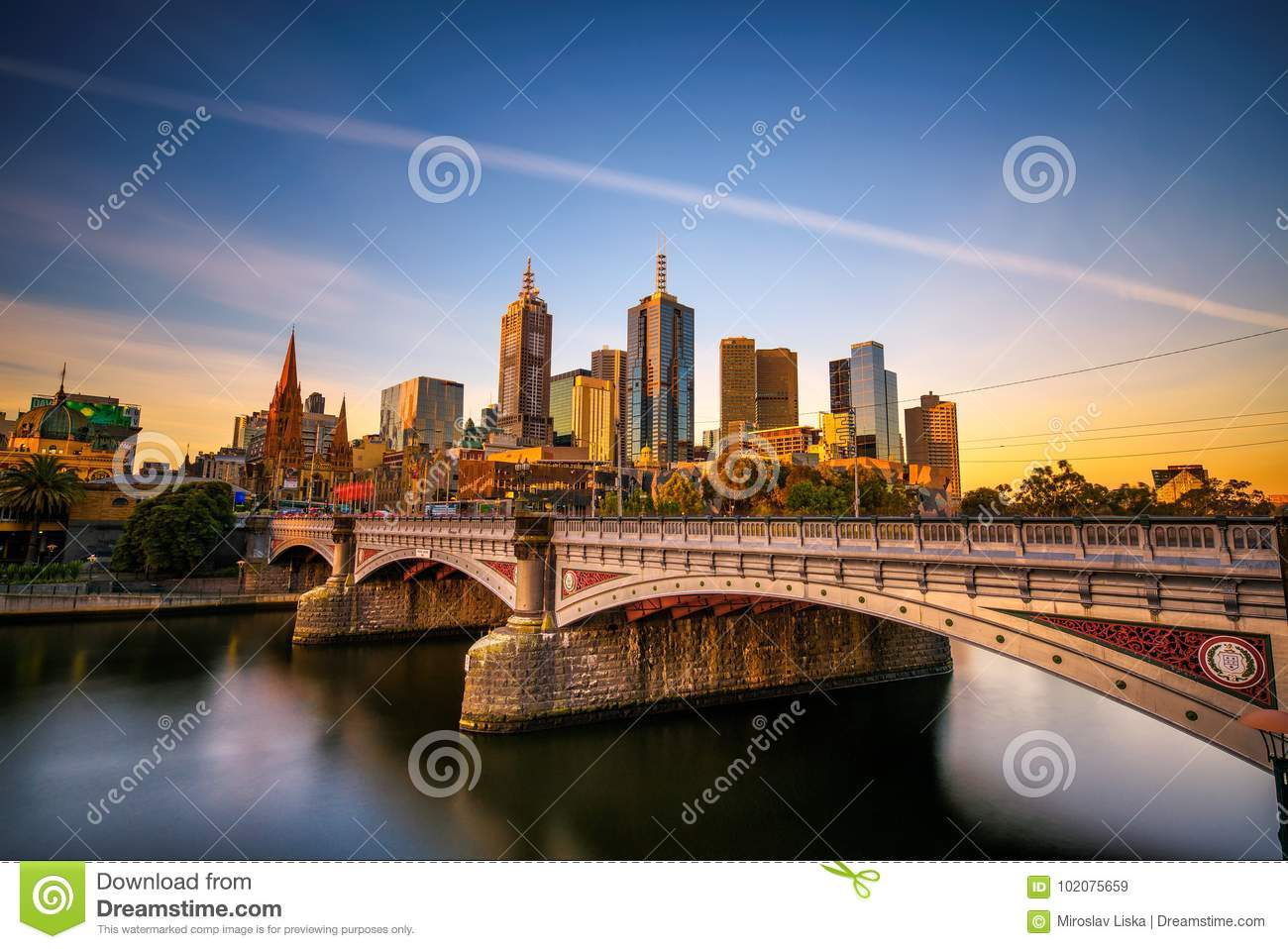 Sunset over skyline of Melbourne downtown, Princess Bridge and Yarra River