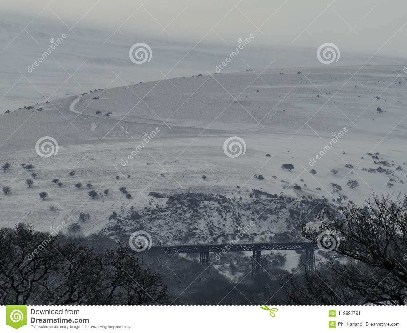 Meldon viaduct in the snow with Longstone Hill in the background, Dartmoor