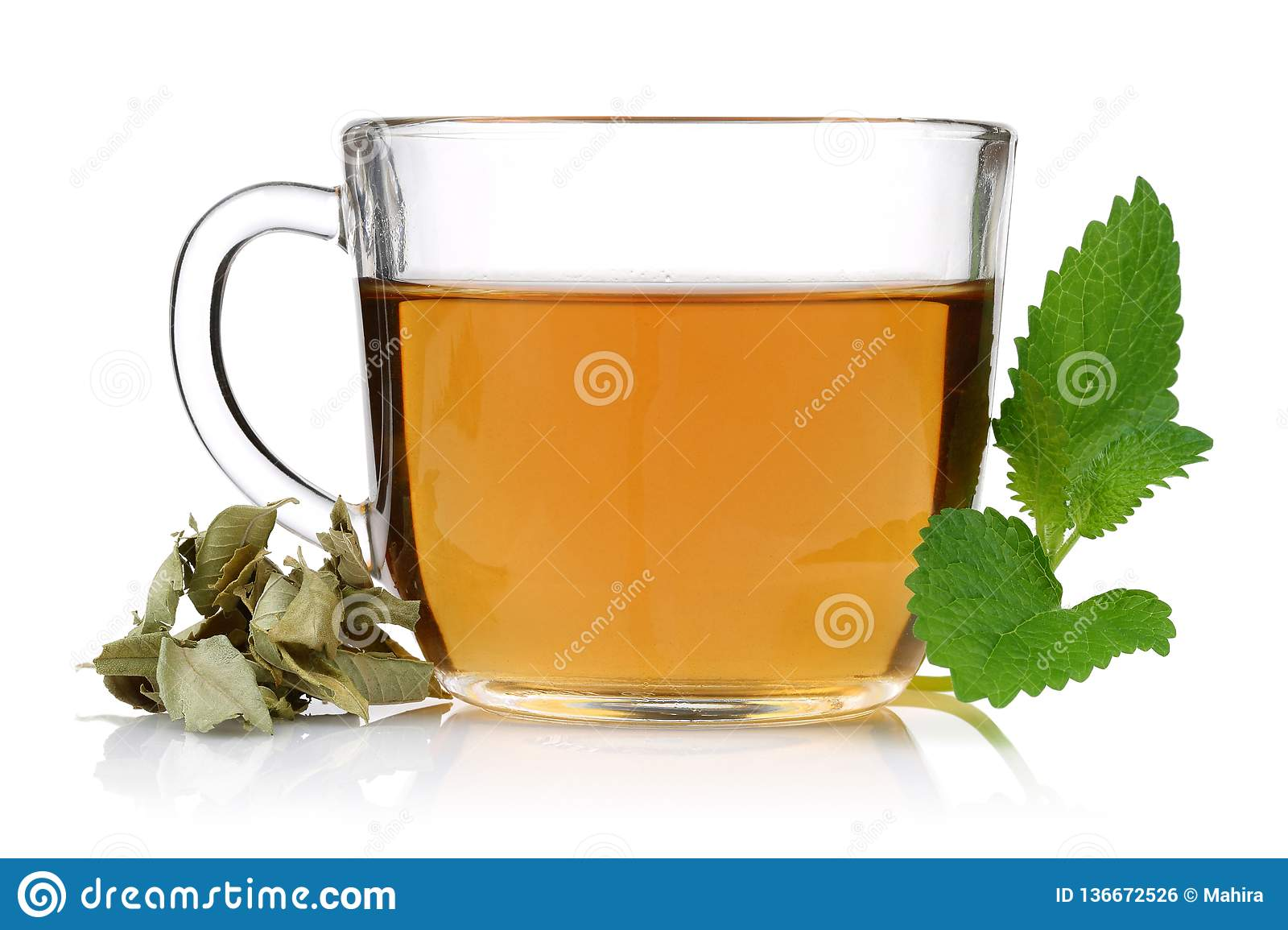 Melissa tea in a glass cup with lemon balm