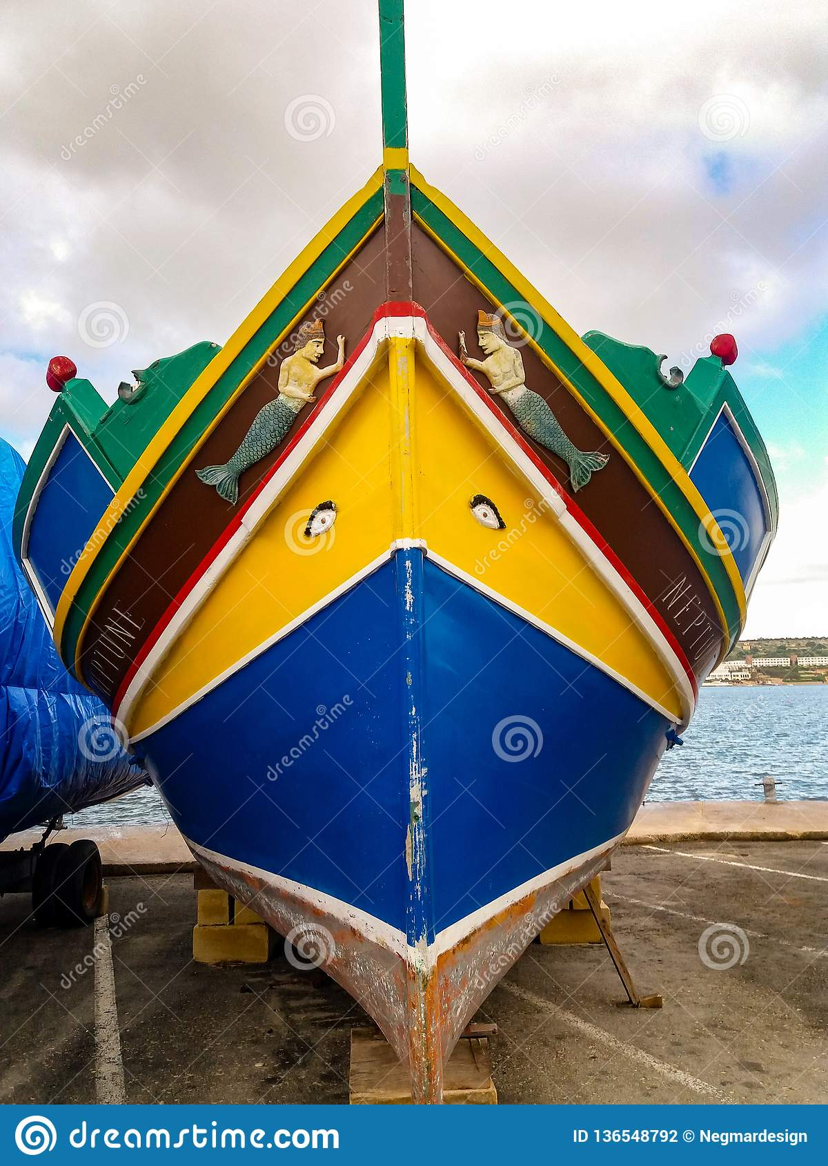 Mellieha, Malta, 30 december 2018 - Traditional colorfull maltese fishing boat, Maltese luzzu, with Eyes of Osiris