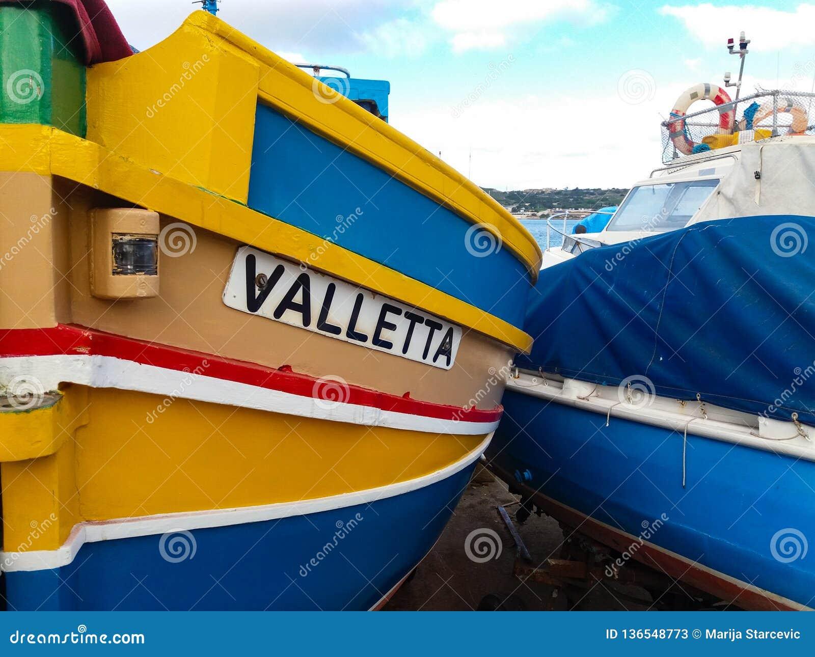 Mellieha, Malta, 30 december 2018 - Traditional colorfull maltese fishing boat, Maltese luzzu, with Eyes of Osiris