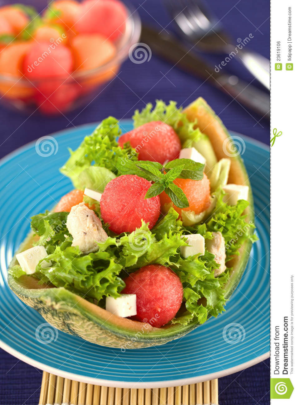 Fresh salad made of watermelon, cantaloupe melon, chicken, cucumber ...