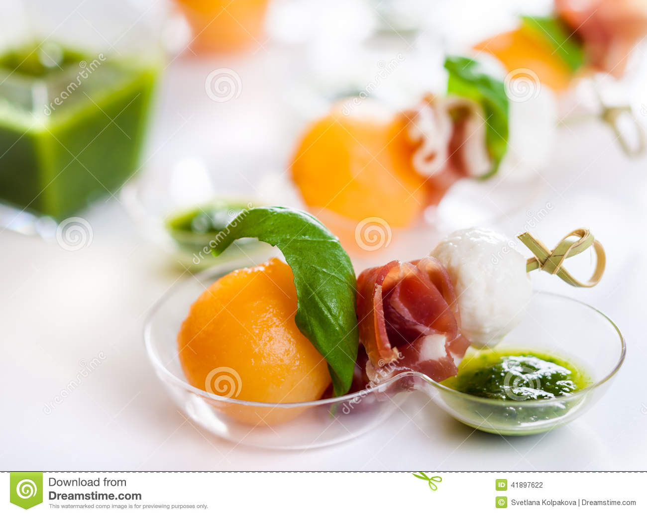 Melon mozzarella and prosciutto on skewers stock photo for Prosciutto and melon canape