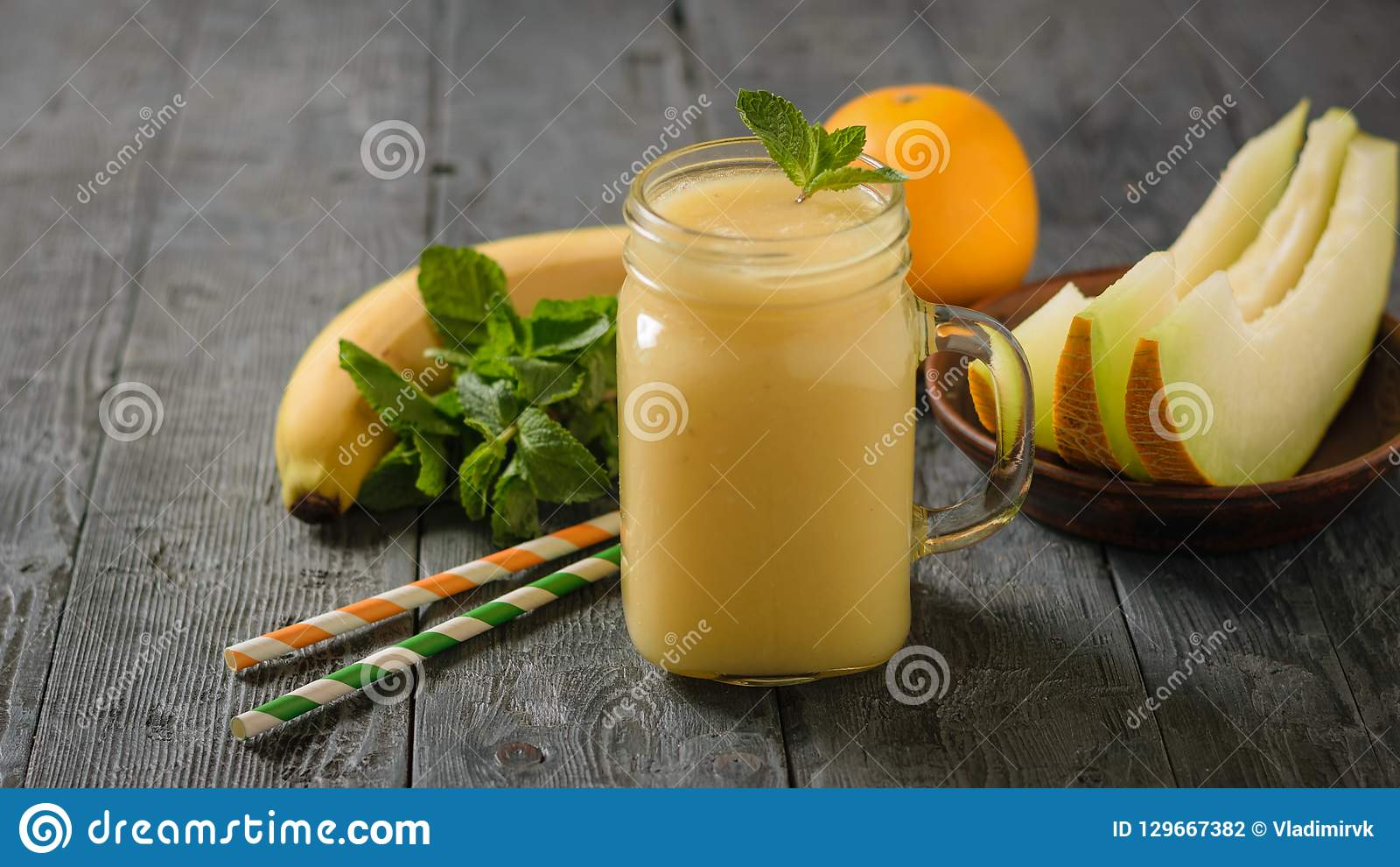 Melon Smoothie Mug With Mint Leaves, Melon Slices And Cocktail Tubes