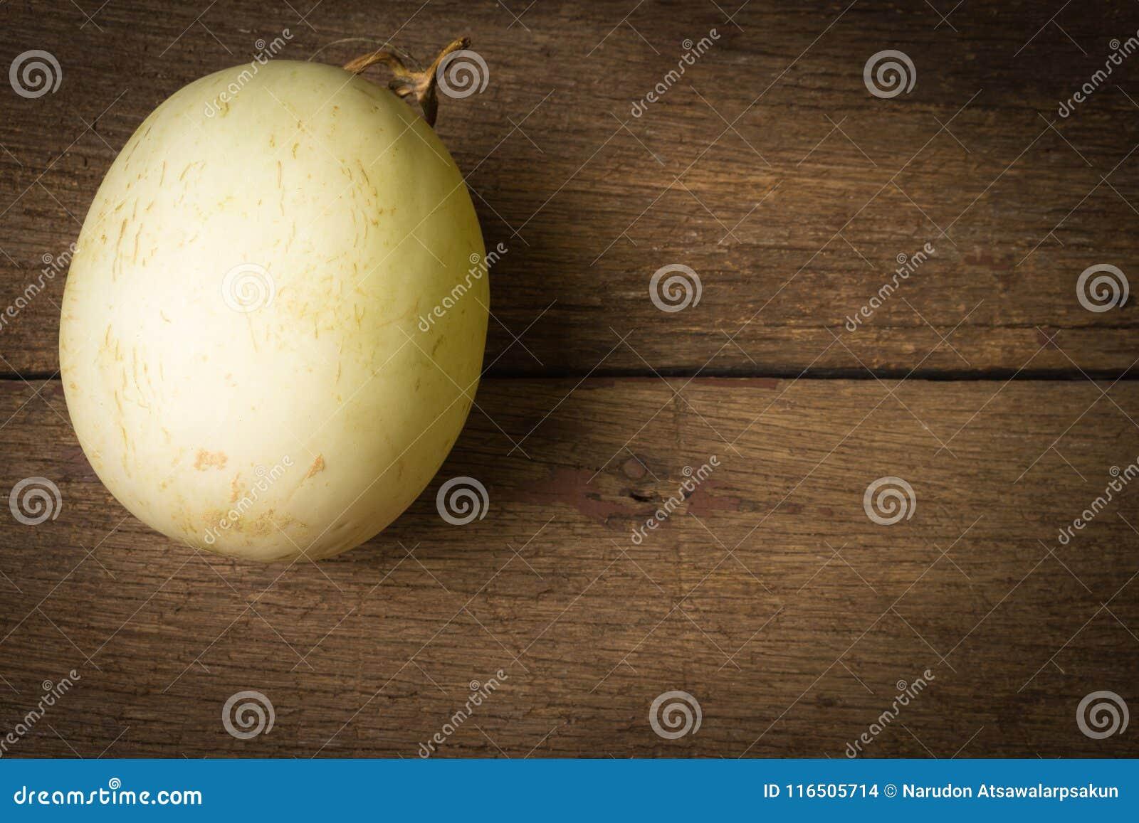 Melon ( sunlady) på gammalt trä Morgon