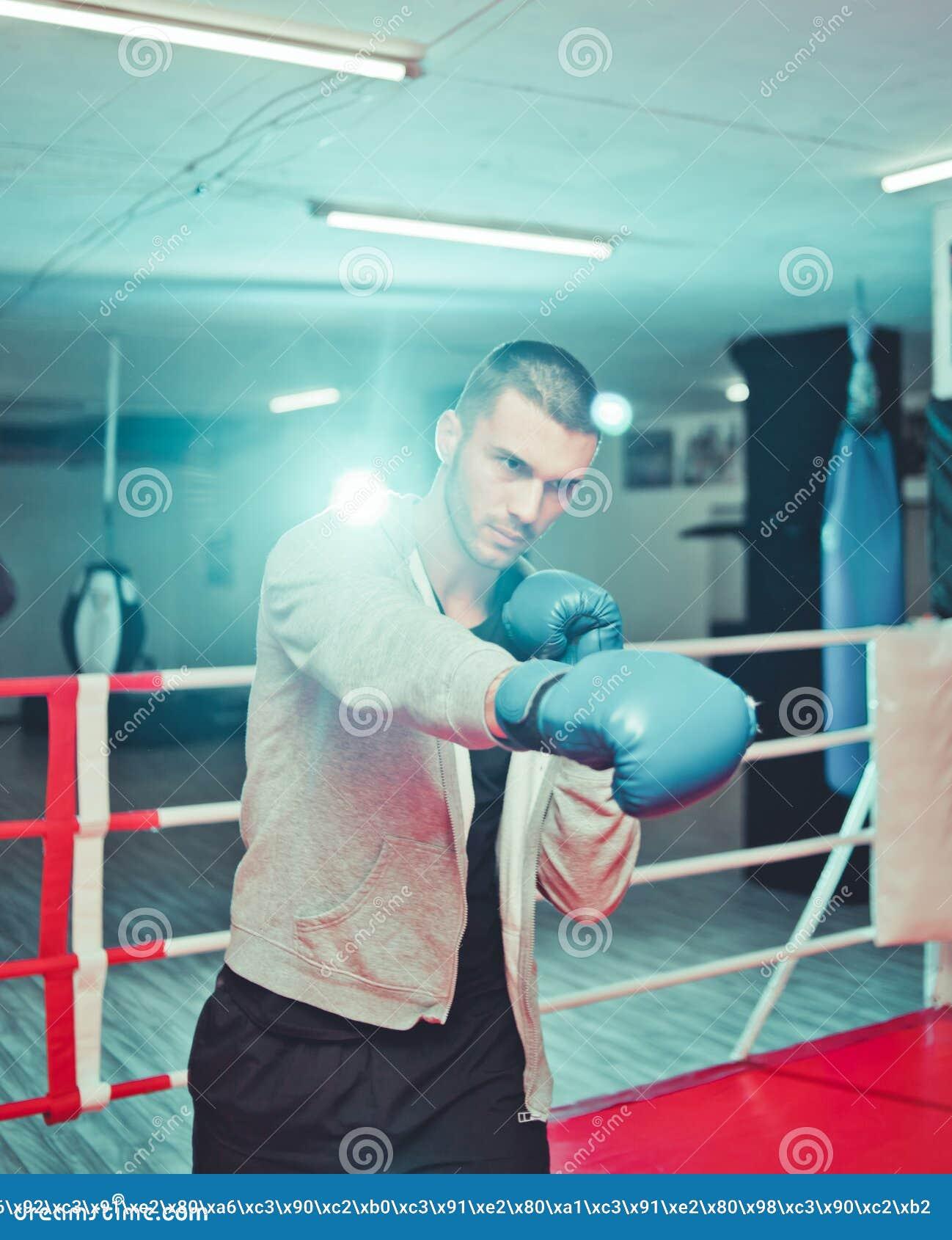 Men boxer doing shadow boxing