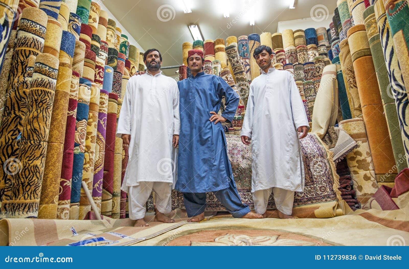 Men At The Carpet Souk In Abu Dhabi Editorial Photo - Image of