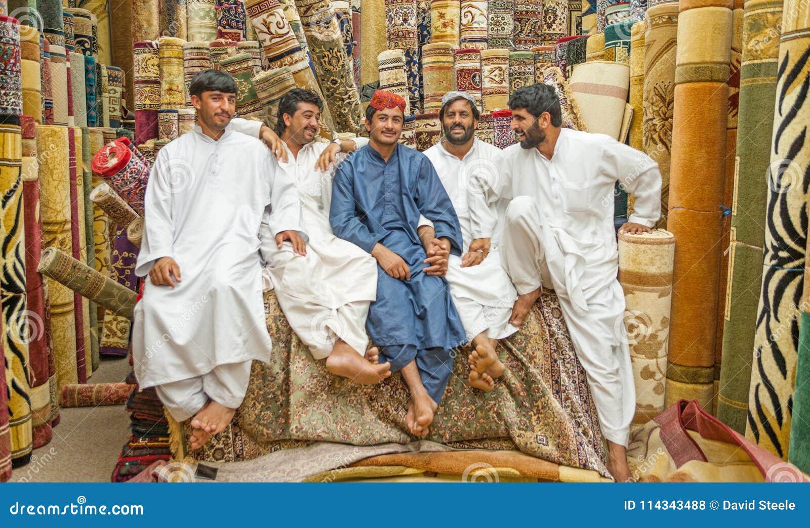 Men At The Carpet Souk In Abu Dhabi Editorial Stock Photo - Image of