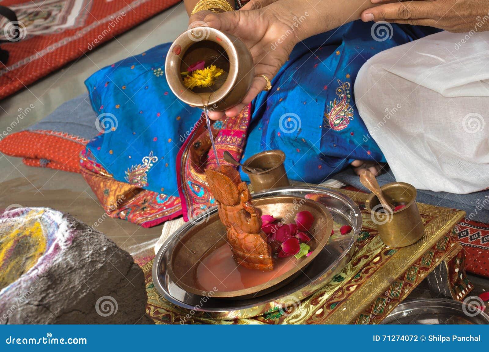 Men Doing Pray Of Lord Ganesha Stock Photo - Image of coconut