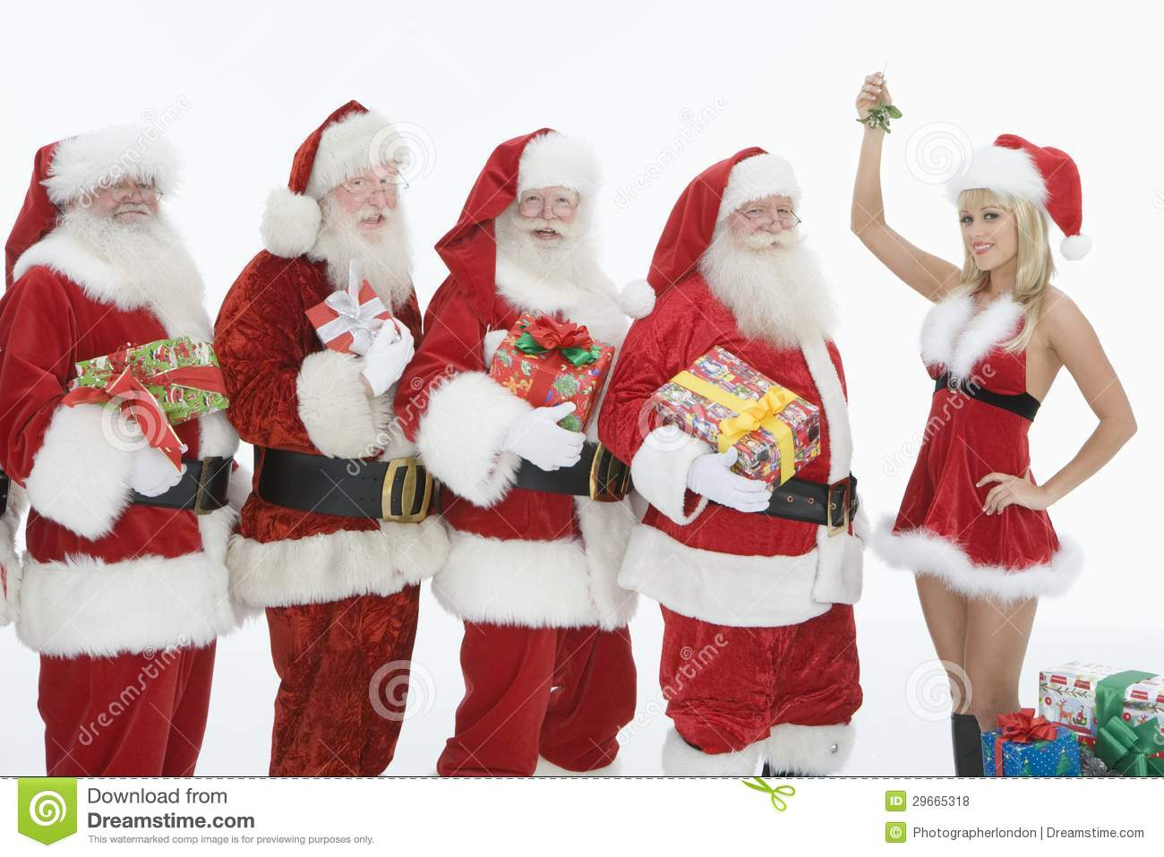 Men dressed in santa claus outfits with mrs holding