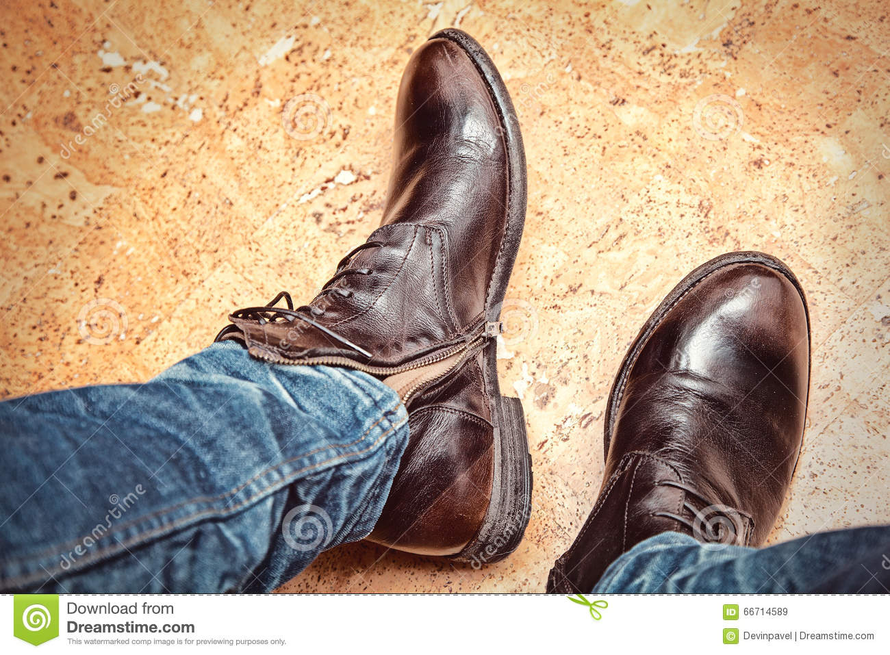Men Fashion Legs In Blue Jeans And Brown Leather Boots Stock Image