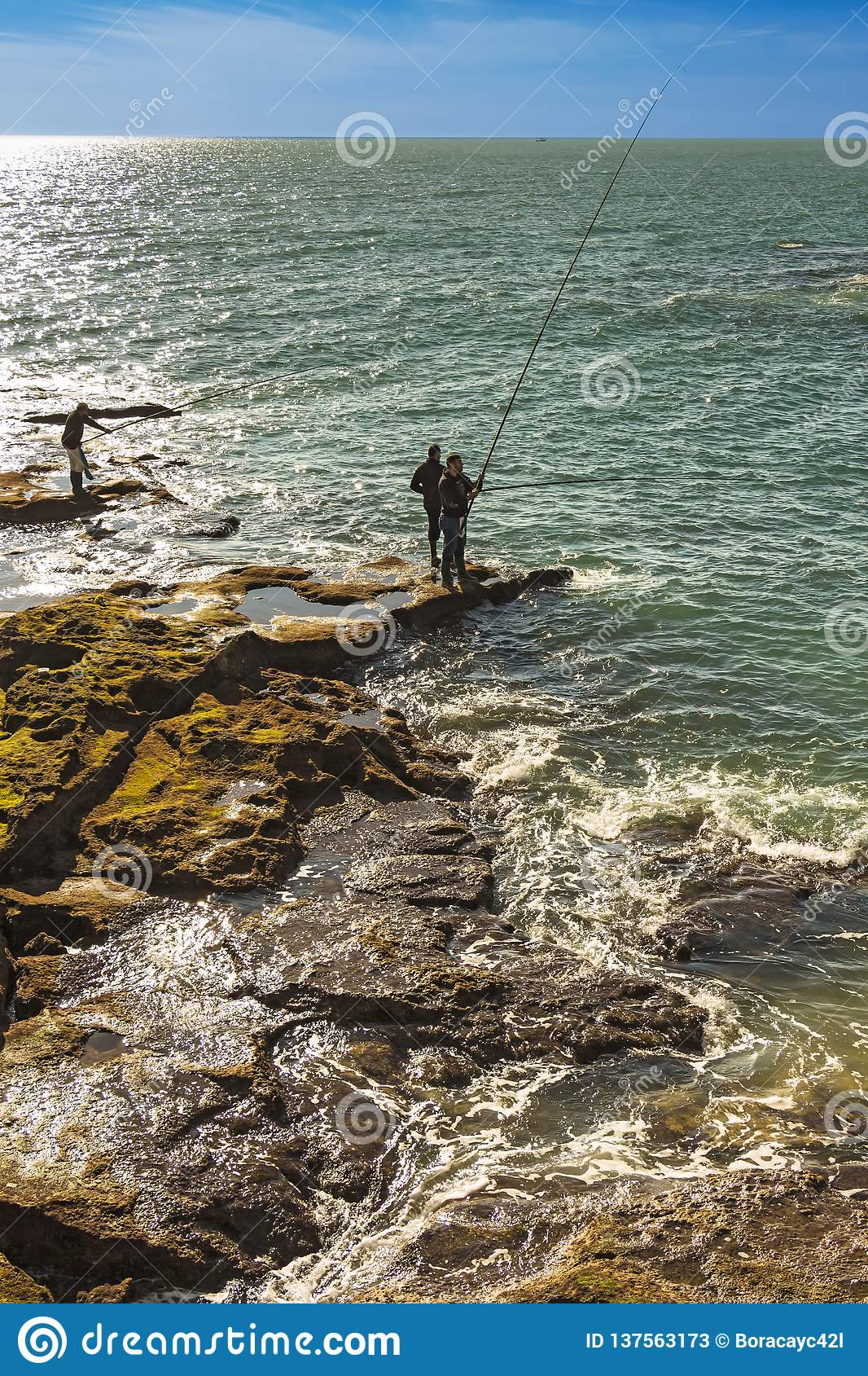 Men fishing off the rocks of Paseo Fernando Quinones in Cadiz