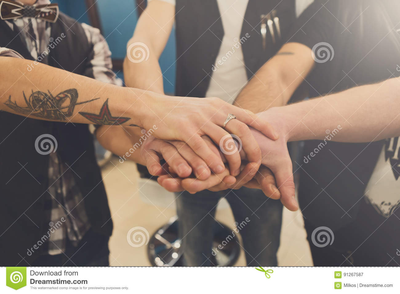 Men Friendship United Hands Of Young Team With Tattoo Stock Image
