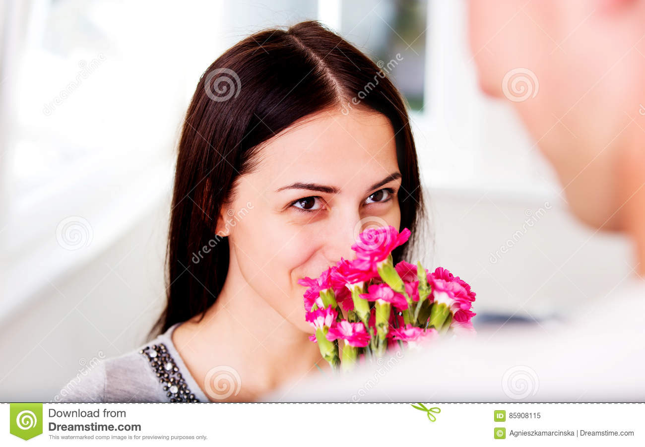 Anniversary Men Giving Flowers To His Lover Woman
