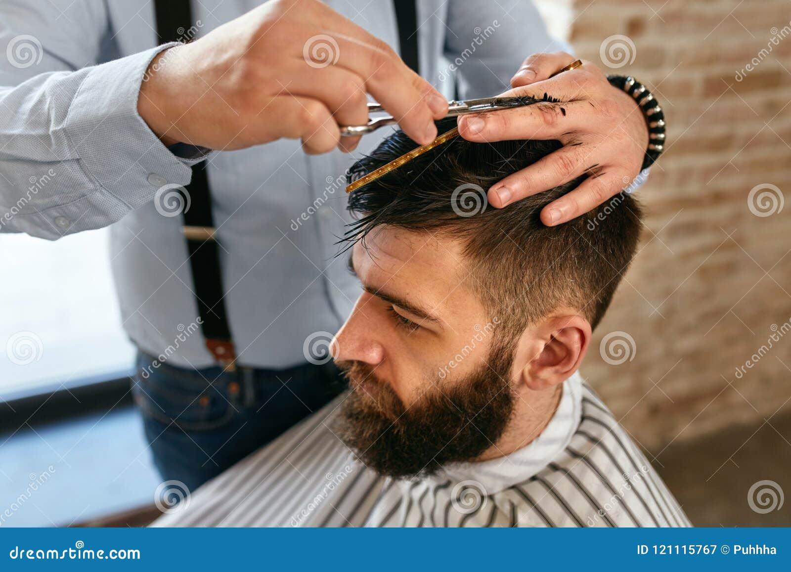 Men Haircut. Barber Cutting Man`s Hair In Barber Shop Stock Image