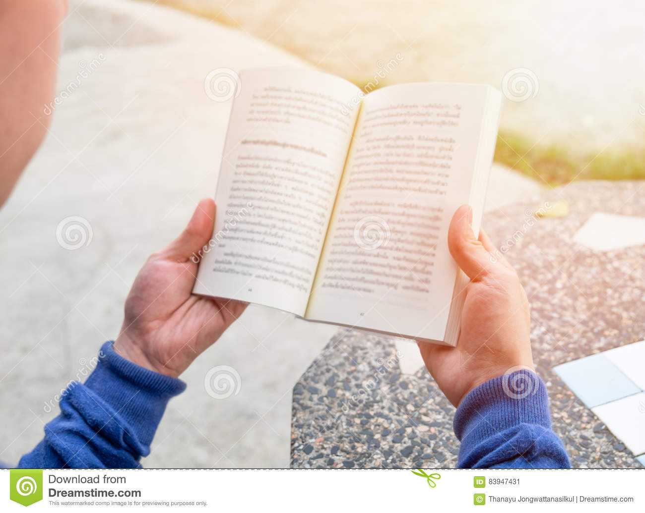 Men holding reading book