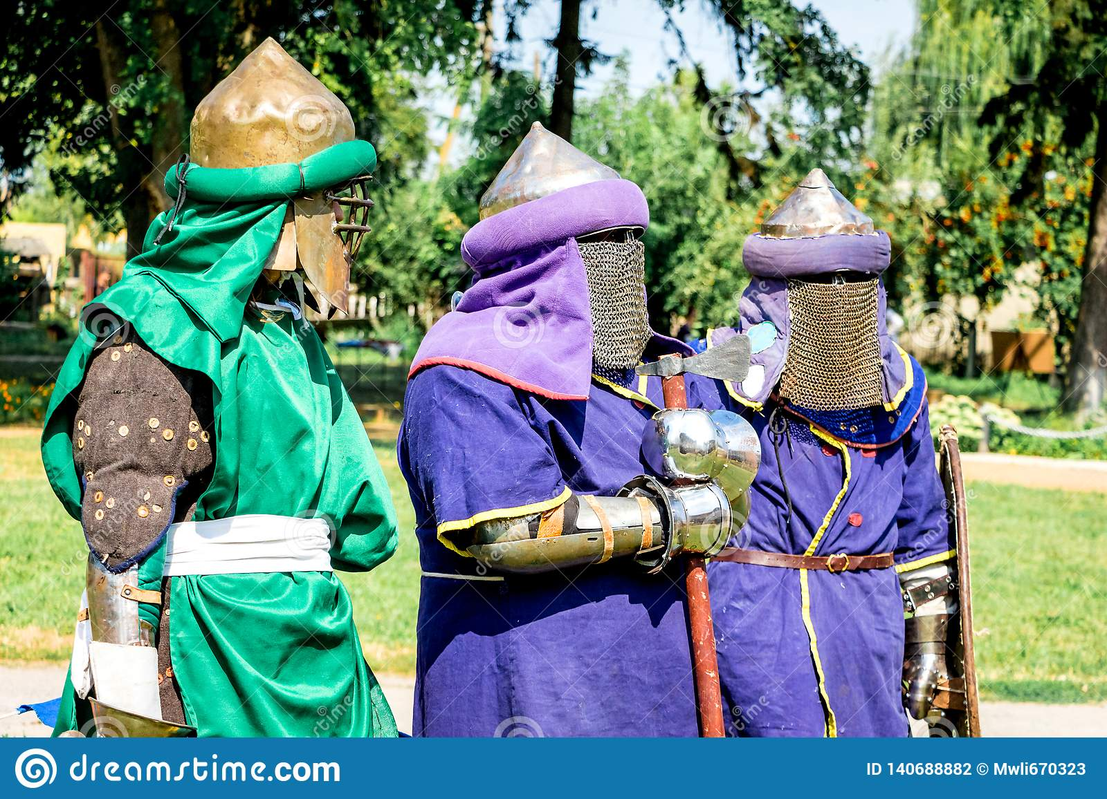 Men in Medieval Warriors` Clothes before the Fight_