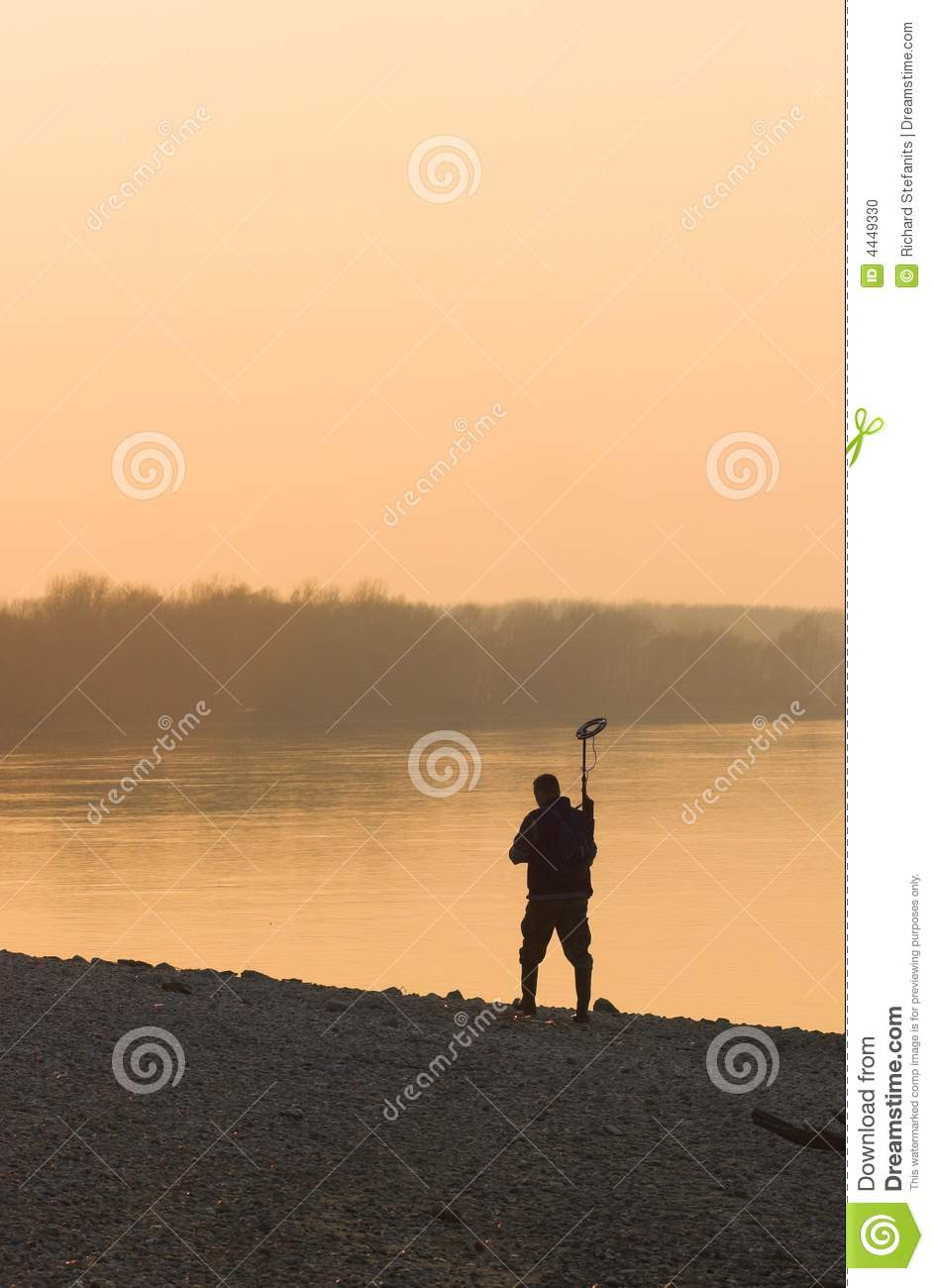 Jew Detector: Men With Metal Detector In Sunset Stock Photo