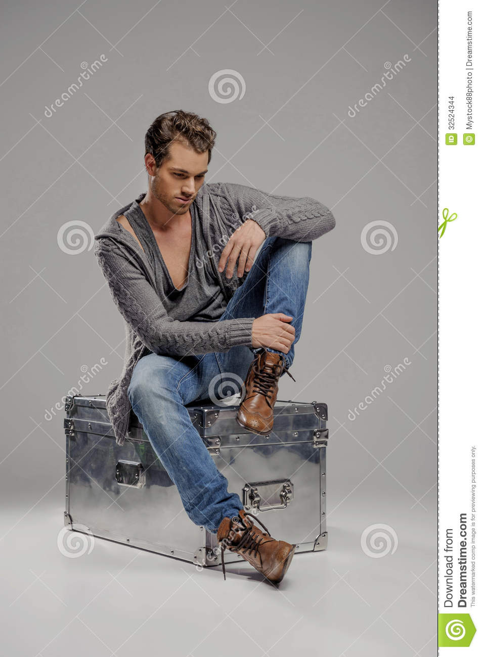 Men With Mysterious Box. Thoughtful Young Men Sitting On ...