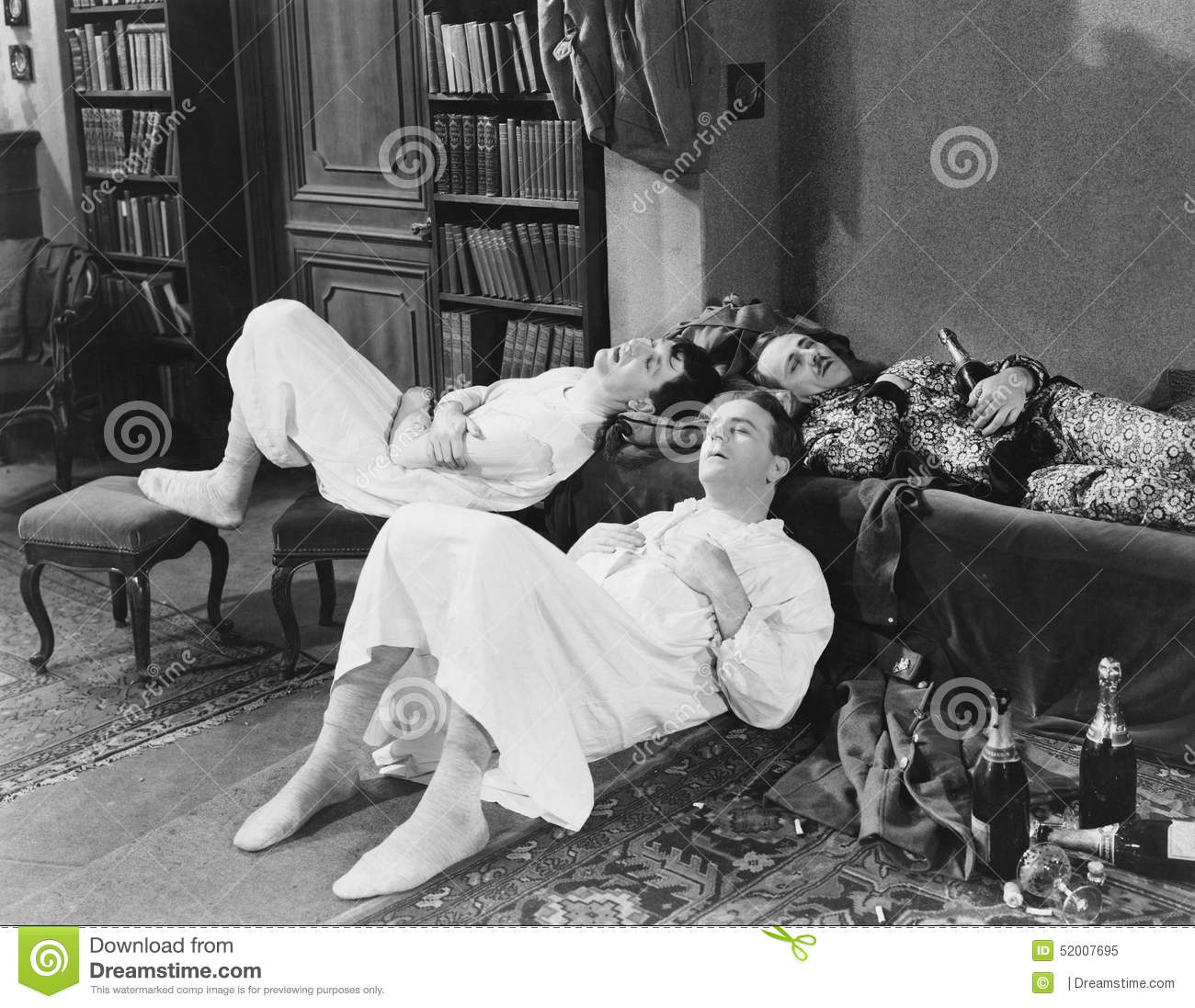 Men passed out with champagne bottles