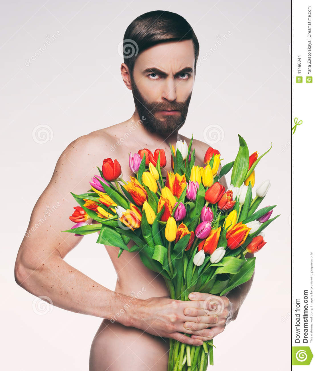 Men portrait with a bouquet of flowers stock photo image of men portrait with a bouquet of flowers izmirmasajfo Image collections