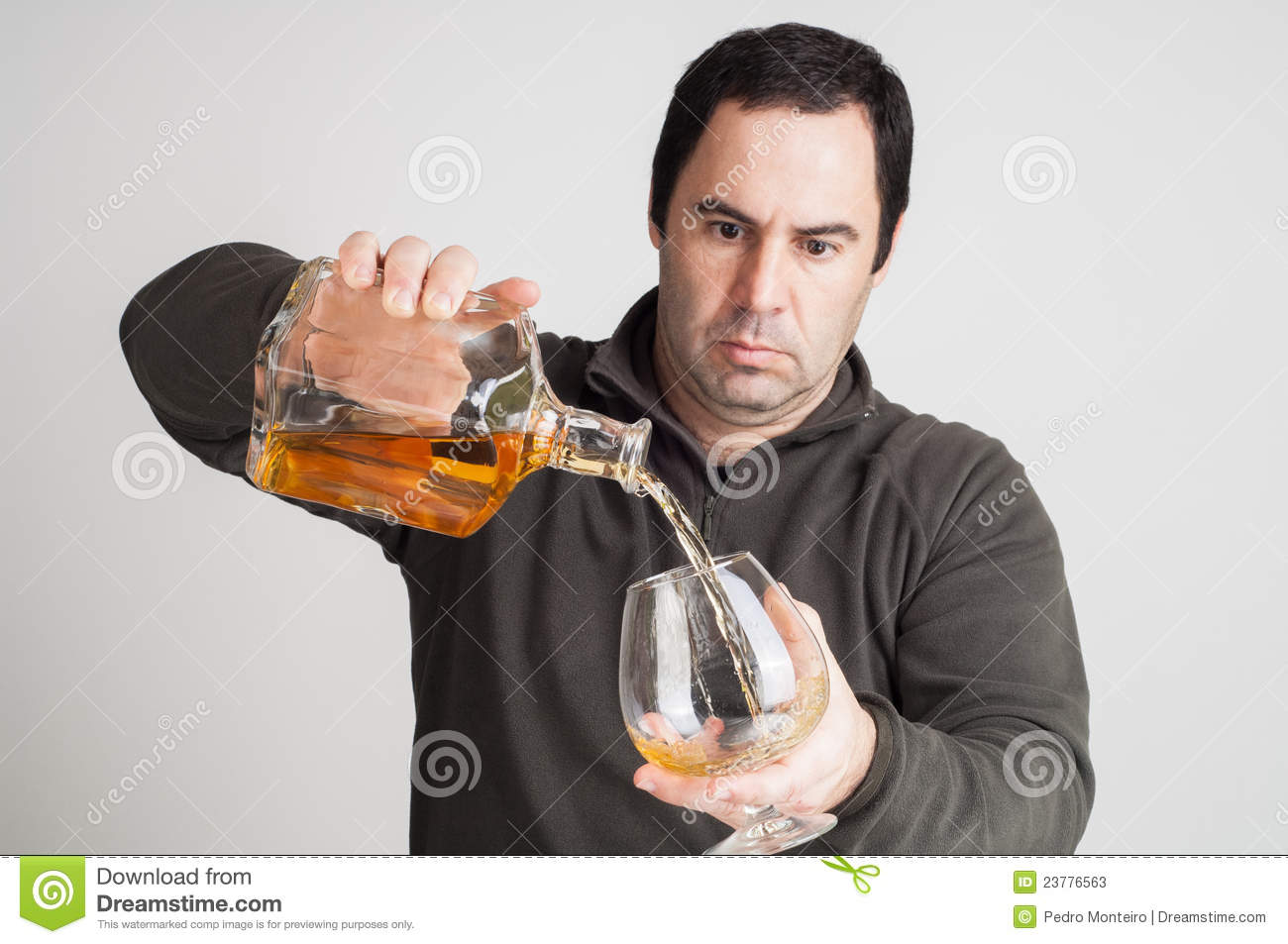 Men pouring a glass of whiskey stock photos image 23776563 for Big whiskey s
