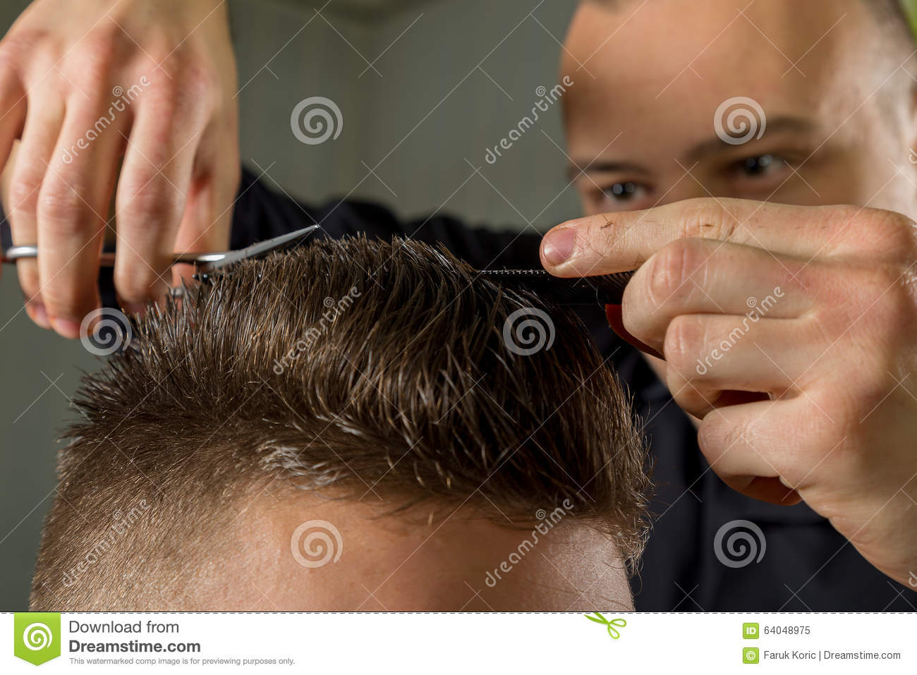 Men s hair cutting with scissors in a beauty salon