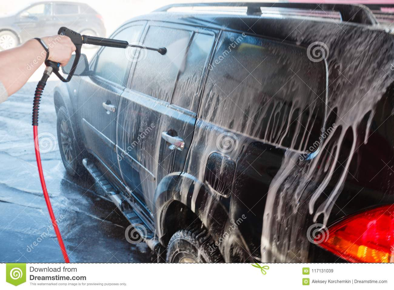 Men S Hand Wash Dirty Suv By High Pressure Wash Touchless Car Wash